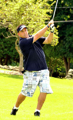 Howie Busse plays in the 22nd Annual Danbury Amateur golf championship at Richter Park Golf Course Sunday, July 22, 2012. Photo: Michael Duffy