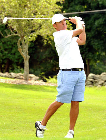 Ned Zacher plays in the 22nd Annual Danbury Amateur golf championship at Richter Park Golf Course Sunday, July 22, 2012. Photo: Michael Duffy / The News-Times