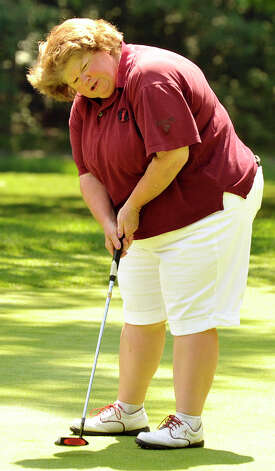 Sandra Jackson plays in the 22nd Annual Danbury Amateur golf championship at Richter Park Golf Course Sunday, July 22, 2012. Photo: Michael Duffy / The News-Times