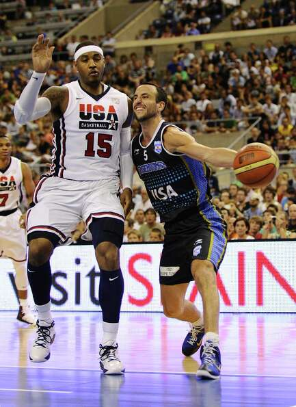 BARCELONA, SPAIN - JULY 22:  Emanuel Ginobili #5 of the Argentina Men's Senior National Team drives