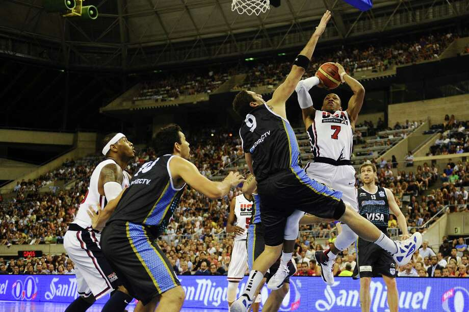 BARCELONA, SPAIN - JULY 22:  Russell Westbrook #7 of the US Men's Senior National Team shoots against Juan Pedro Gutierrez #9 of the Argentina Men's Senior National Team during a Pre-Olympic Men's Exhibition Game between USA and Argentina at Palau Sant Jordi, on July 22, 2012 in Barcelona, Spain. Photo: David Ramos, Getty Images / 2012 Getty Images