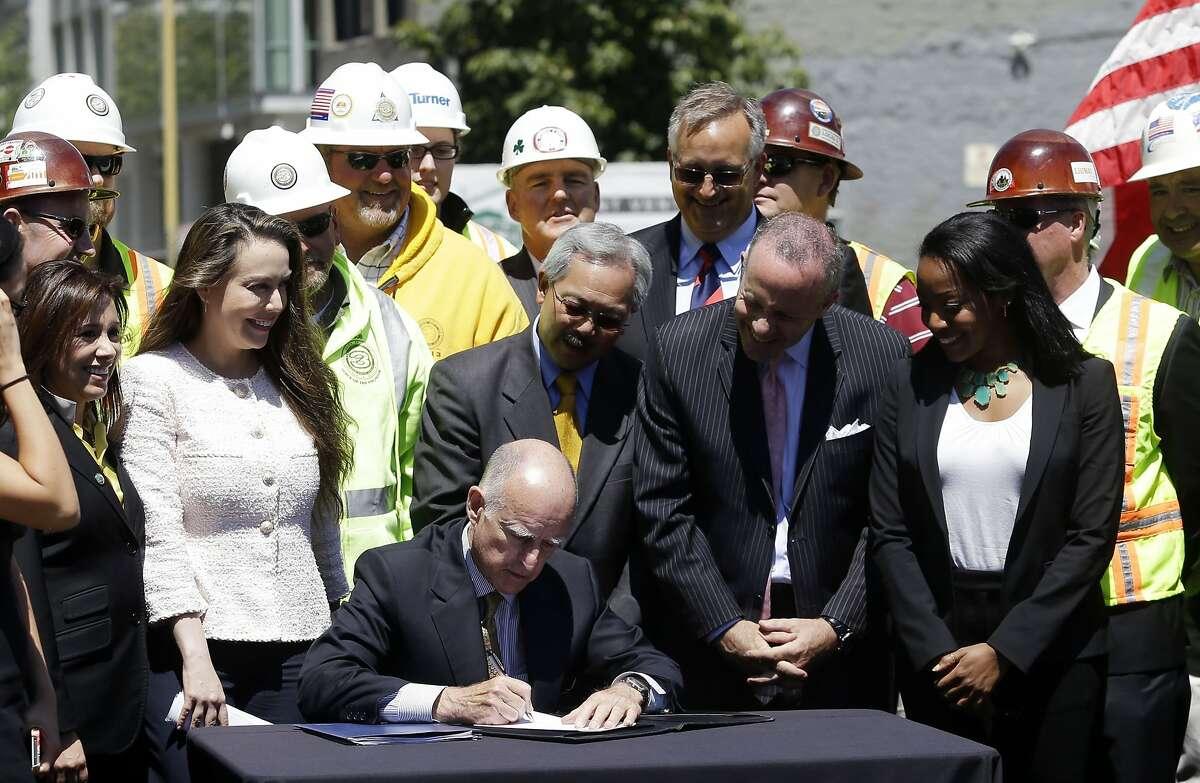 California Gov. Jerry Brown signs legislation authorizing initial construction of California's $68 billion high-speed rail line in San Francisco, Wednesday, July 18, 2012. (AP Photo/Marcio Jose Sanchez)