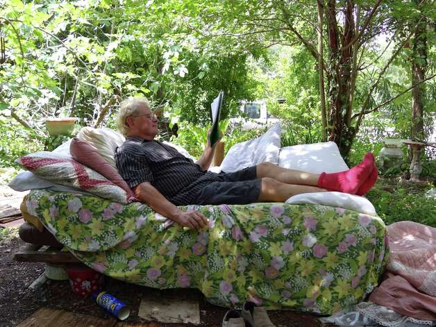 Gene Elder relaxes in a wooded area in the River Road neighborhood on Tuesday, July 10, 2012. Photo: Billy Calzada, San Antonio Express-News / © 2012 San Antonio Express-News