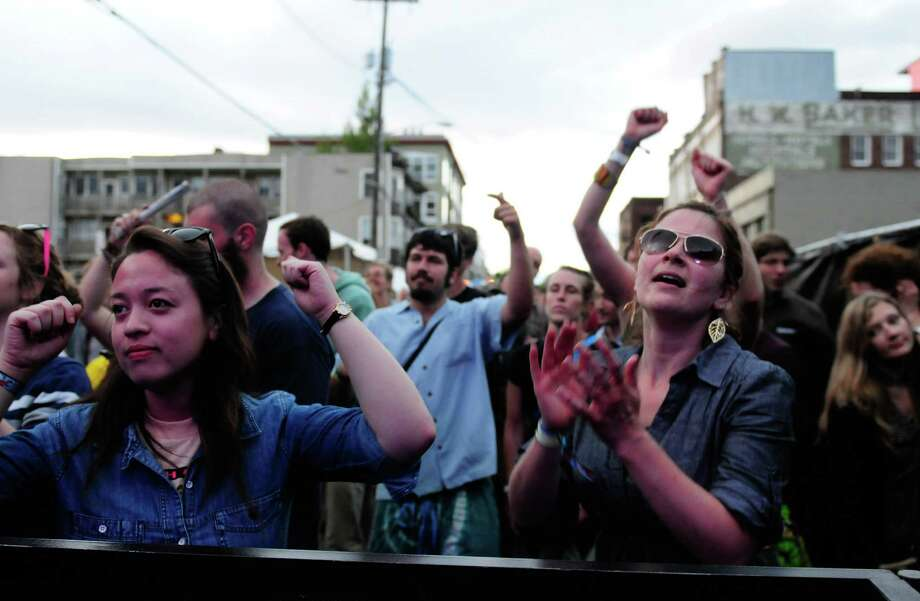 Fans dance to the music of Janka Nabay. Photo: LINDSEY WASSON / SEATTLEPI.COM