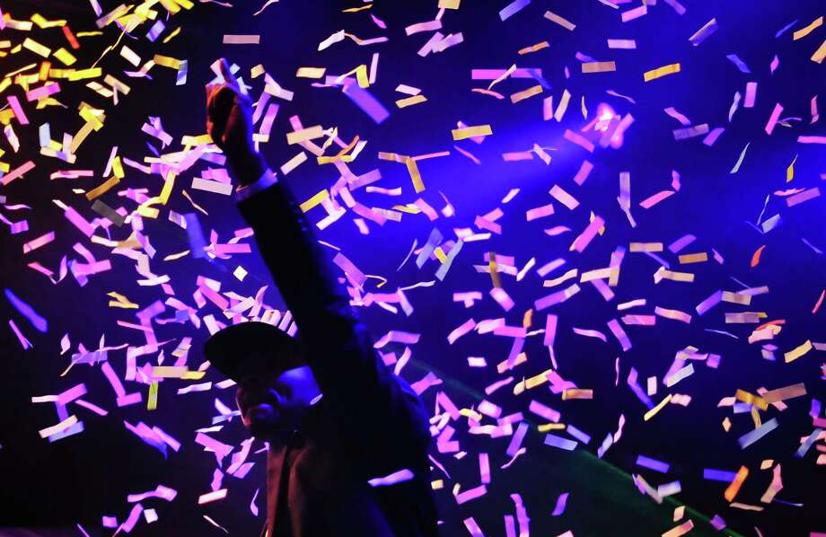 Major Lazer points to the sky as confetti rains down on the stage on Saturday. Photo: LINDSEY WASSON / SEATTLEPI.COM