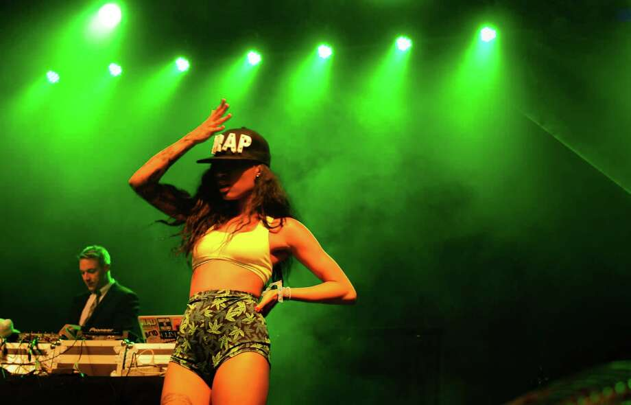 A dancer with Major Lazer throws up her hand during a performance. Photo: LINDSEY WASSON / SEATTLEPI.COM