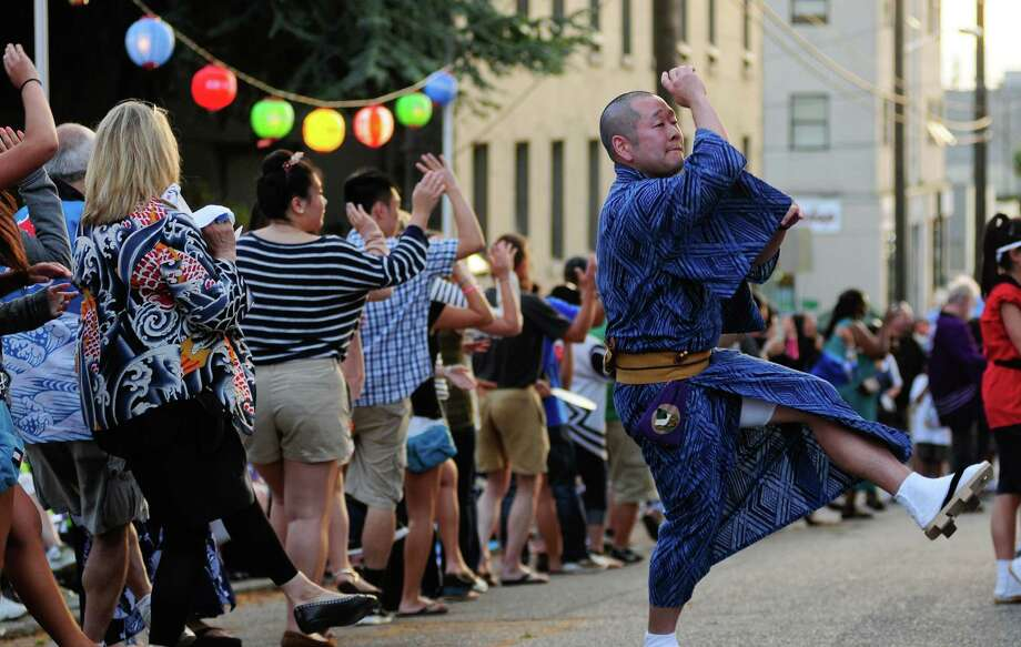 Line leader Tyler Moriguchi kicks up his leg as he performs Fukushima Ondo. Photo: LINDSEY WASSON / SEATTLEPI.COM