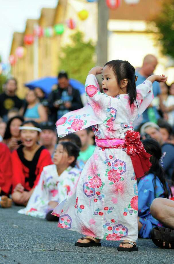 Emiko Young, 3, dances enthusiastically as she watches One World Taiko. Photo: LINDSEY WASSON / SEATTLEPI.COM
