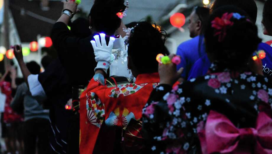People dressed in traditional ware perform Hanabi Ondo with blinking lights. Photo: LINDSEY WASSON / SEATTLEPI.COM