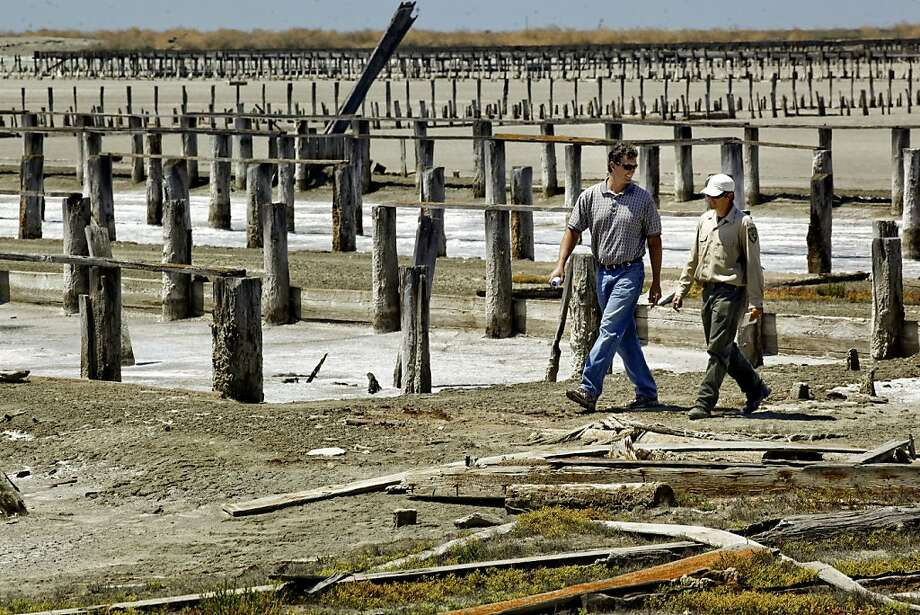Steve Carroll, (left) regional engineer with Ducks Unlimited, and John Krause, the Department of Fish and Game, walk near the old Oliver Salt Works in Hayward on May 31. Photo: Michael Macor, The Chronicle
