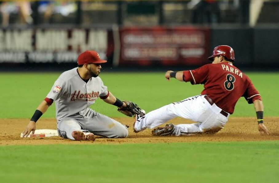 Astros shortstop Marwin Gonzalez tags out Diamondbacks right fielder Gerardo Parra. (Norm Hall / Get