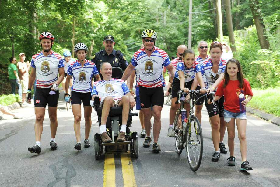 From left, Joe Profaci, Annie Dino, Greenwich Police Sgt. John Slusarz, Roger Petrone, Lt. Richard Cochran, Detective William Weissauer, Petrone's daughter Sydney Petrone, Police Officer Bob Ferretti, Molly Urell-Poe and her daughter Kelse, 10, at the end of the ALS TDI Tri-State Trek in Greenwich, Sunday, July 22, 2012. Roger Petrone has ALS. The three-day, 270-mile bicycle ride began in Newton, Mass., Friday and ended in Greenwich Sunday afternoon, and raises money for ALS research. Photo: Helen Neafsey / Greenwich Time