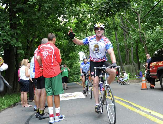 Greenwich Police Lt. Richard Cochran at the end of the ALS TDI Tri-State Trek in Greenwich, Sunday, July 22, 2012. The three-day, 270-mile bicycle ride began in Newton, Mass., Friday and ended in Greenwich Sunday afternoon, and raises money for ALS research. Photo: Helen Neafsey / Greenwich Time