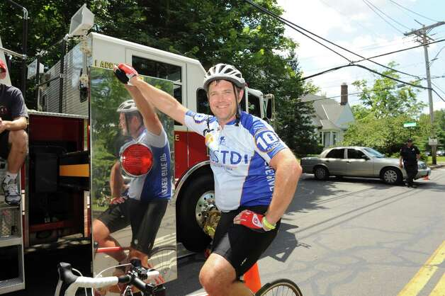 Tadhg Morgan, of Boston, at the end of the ALS Immune Disease Institute Tri-State Trek-in Greenwich, Sunday, 22, 2012. The three day, 270-mile bicycle ride began in Newton MA on Friday and ended in Greenwich Sunday afternoon. The event raises money for ALS research. Photo: Helen Neafsey / Greenwich Time