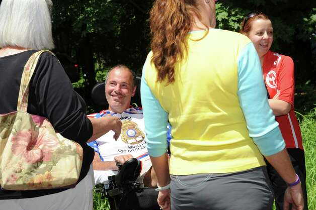 Roger Petrone smiles  at the end of the ALS TDI Tri-State Trek in Greenwich, Sunday, 22, 2012. The three-day, 270-mile bicycle ride began in Newton MA on Friday and ended in Greenwich Sunday afternoon. The event raises money for ALS research. Photo: Helen Neafsey / Greenwich Time