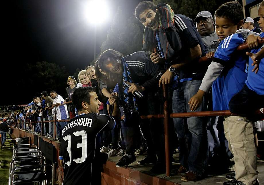 The Quakes' Steven Beitashour gets together with home fans. Photo: Michael Macor, The Chronicle