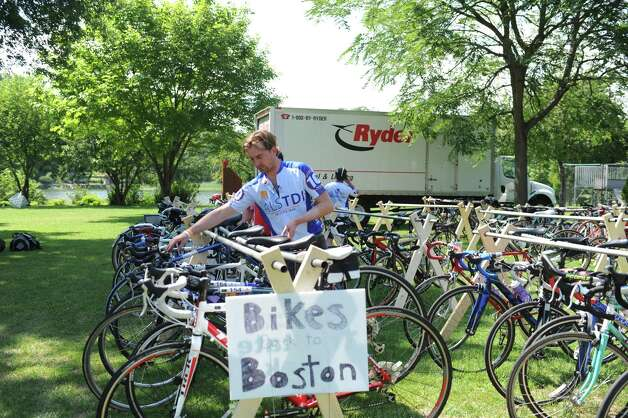 Travis Reik, of Sommerville, MASS, parking his bike at the end of the ALS Immune Disease Institute Tri-State Trekin Greenwich, Sunday, 22, 2012. The three day, 270-mile bicycle ride began in Newton MA on Friday and ended in Greenwich Sunday afternoon. The event raises money for ALS research. Photo: Helen Neafsey / Greenwich Time
