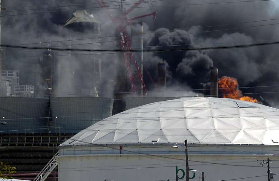Flames erupt from the BP Amoco PLC oil refinery plant in Texas City, Texas after an explosion on Wednesday, March 23, 2005. BP spokesman Neil Chapman confirmed fatalities, but said he did not have a total number. There are ``more than one, '' he said. BP's Texas City plant is a 1,200-acre spread with 30 refinery units. The plant processes 433,000 barrels of crude oil a day. (AP Photo/The Galveston County Daily News, Dwight Andrews) Photo: Dwight Andrews, AP