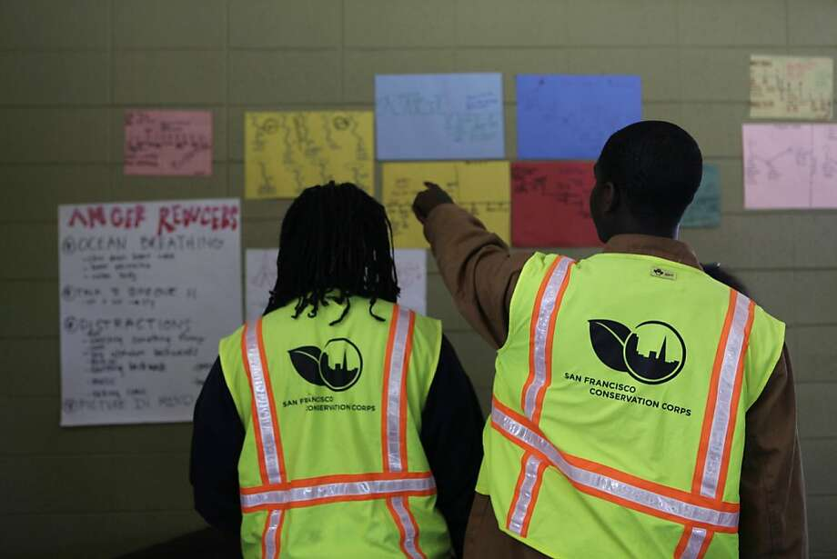 Don and Daejon look over posters analyzing and how to cope with  behaviors at Log Cabin Ranch School on Wednesday, June 6, 2012 in LaHonda, Calif. Photo: Lea Suzuki, The Chronicle