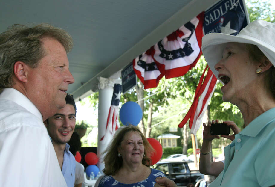 "Paul Sadler talks to supporter Cynthia Butler Sunday July 22, 2012 at a democratic activist ""get out the early vote"" rally at the home of Bob and Jo Anne Comeaux. Sadler faces San Antonio retiree Grady Yarbrough in the race for the Democratic nomination for U.S. Senate. Photo: Julysa Sosa / SAN ANTONIO EXPRESS-NEWS"