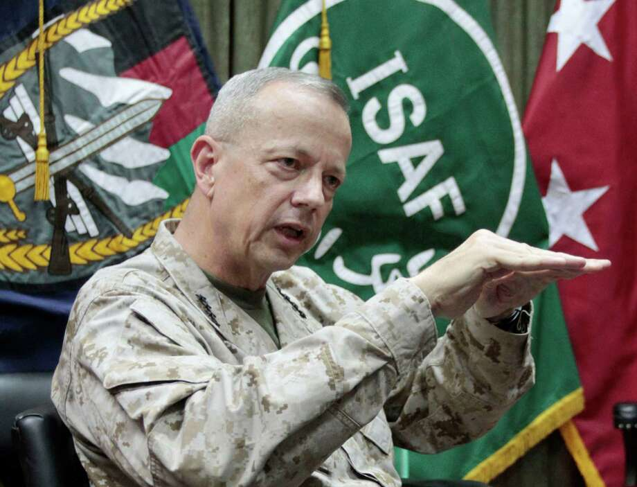 U.S.  Gen. John Allen, top commander of the NATO-led International Security Assistance Forces (ISAF) and US forces in Afghanistan gestures during an interview with the Associated Press in Kabul, Afghanistan, Sunday, July 22, 2012. Gen. Allen says this year's pullout of 23,000 American troops is at the halfway point. He told The Associated Press in an interview Sunday that a significant number will leave in August and early September. (AP Photo/Musadeq Sadeq) Photo: Musadeq Sadeq / AP