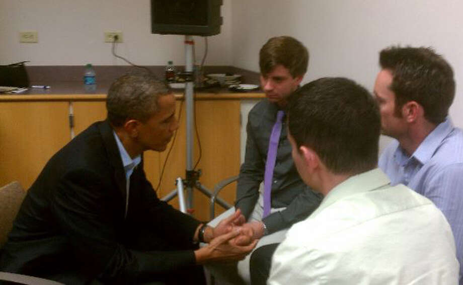 President Barack Obama meets with Jordan Ghawi, center, brother of shooting victim Jessica Ghawi, and former San Antonian Peter Burns, right, in Aurora, Colorado on Sunday, July 22, 2012. Courtesy Photo.