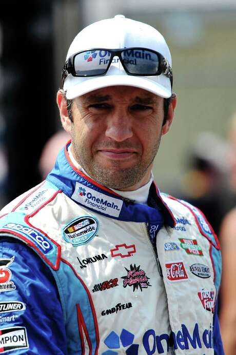 LOUDON, NH - JULY 13:  Elliott Sadler, driver of the #2 OneMain Financial Chevrolet, walks through the garage during practice for the NASCAR Nationwide Series F.W. Webb 200 at New Hampshire Motor Speedway on July 13, 2012 in Loudon, New Hampshire.  (Photo by Drew Hallowell/Getty Images for NASCAR) Photo: Drew Hallowell / 2012 Getty Images