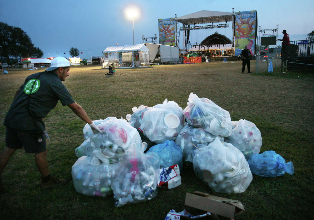 Trash is cleared quickly following final performance on Sunday at the Gathering of the Vibes in Bridgeport.