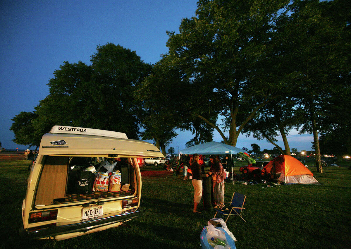 Campers pack up their things following final performance at the Gathering of the Vibes in Bridgeport on Sunday, July 22, 2012.