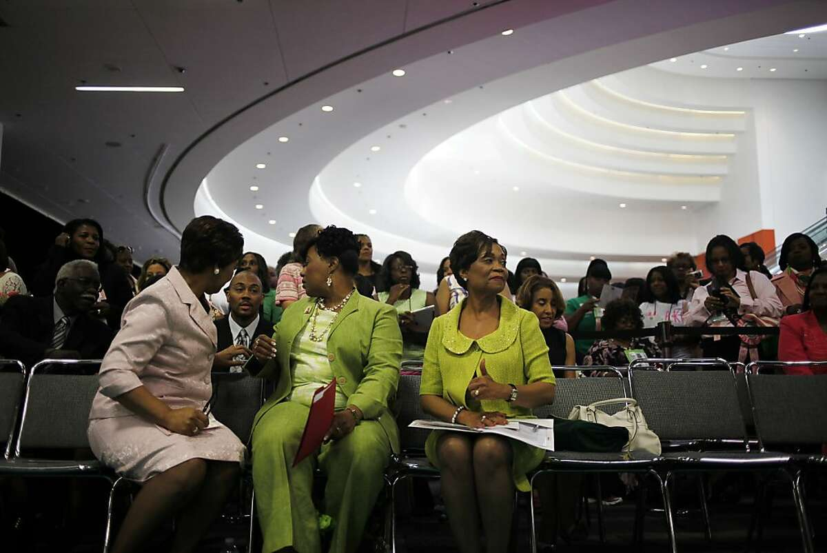 Carolyn House Stewart, right, International President of the AKA sorority, waits for the opening ceremony of the exhibition in Moscone Convention Center which is named: