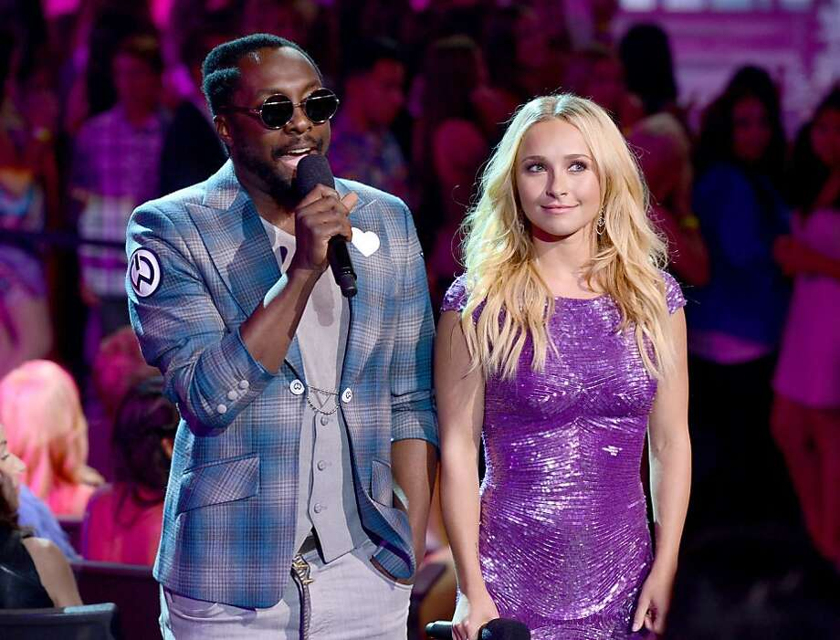 UNIVERSAL CITY, CA - JULY 22:  Rapper will.i.am (L) and actress Hayden Panettiere speak onstage during the 2012 Teen Choice Awards at Gibson Amphitheatre on July 22, 2012 in Universal City, California.  (Photo by Kevin Winter/Getty Images) Photo: Kevin Winter, Getty Images