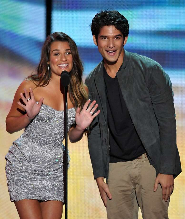 Lea Michele, left, and Tyler Posey speak onstage at the Teen Choice Awards on Sunday, July 22, 2012, in Universal City, Calif. (Photo by John Shearer/Invision/AP) Photo: John Shearer, Associated Press