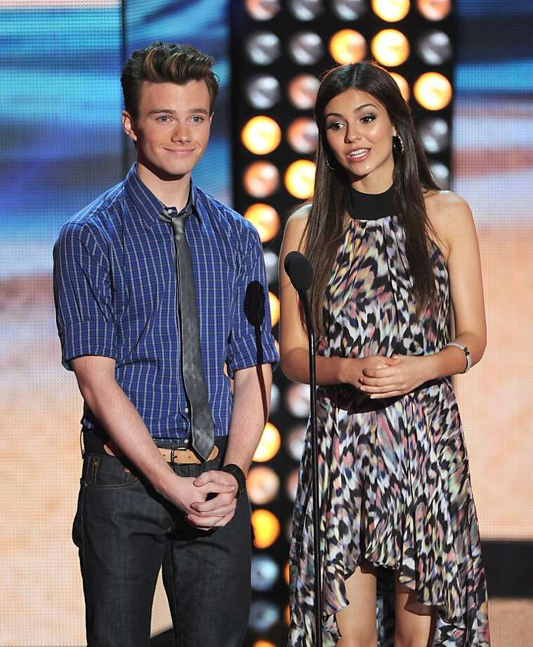 UNIVERSAL CITY, CA - JULY 22:  Actors Chris Colfer (L) and Victoria Justice speak onstage during the 2012 Teen Choice Awards at Gibson Amphitheatre on July 22, 2012 in Universal City, California.  (Photo by Kevin Winter/Getty Images) Photo: Kevin Winter, Getty Images