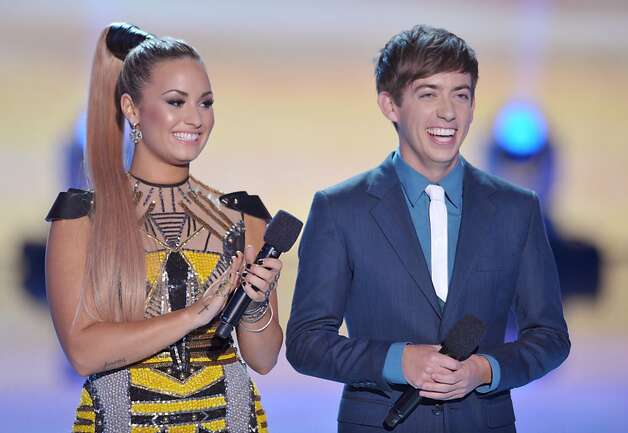 Hosts Demi Lovato, left, and Kevin McHale speak onstage at the Teen Choice Awards on Sunday, July 22, 2012, in Universal City, Calif. (Photo by John Shearer/Invision/AP) Photo: John Shearer, Associated Press