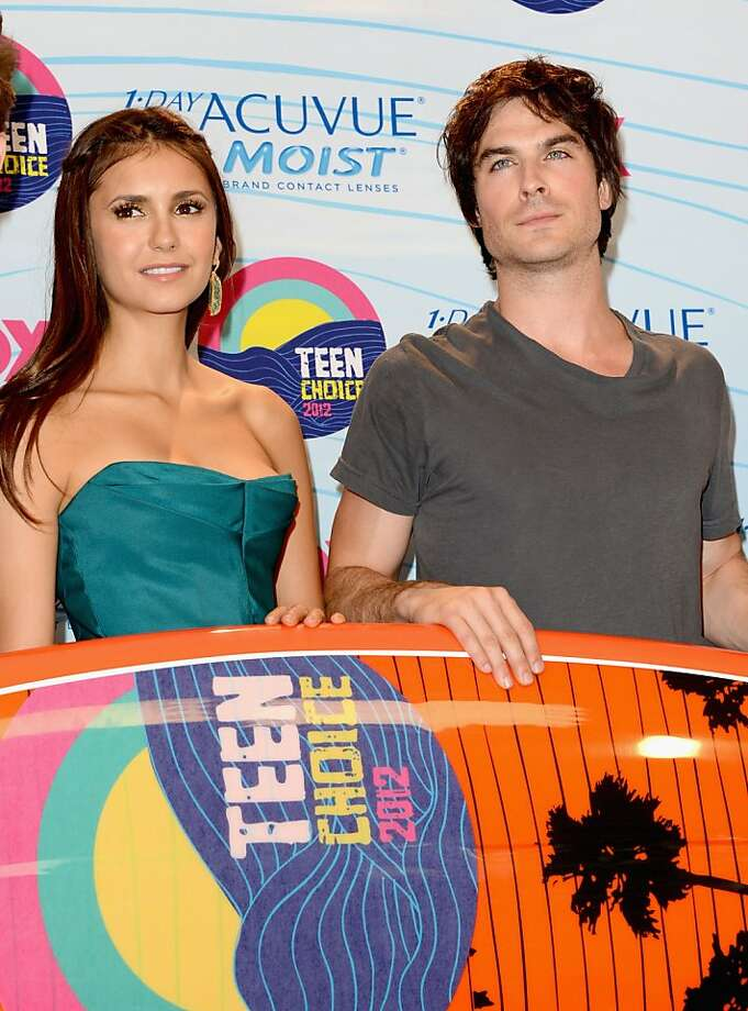 UNIVERSAL CITY, CA - JULY 22:  Actors Nina Dobrev and Ian Somerhalder, winners of Choice Fantasy/Sci-Fi Show award, pose in the press room during the 2012 Teen Choice Awards at Gibson Amphitheatre on July 22, 2012 in Universal City, California.  (Photo by Jason Merritt/Getty Images) Photo: Jason Merritt, Getty Images