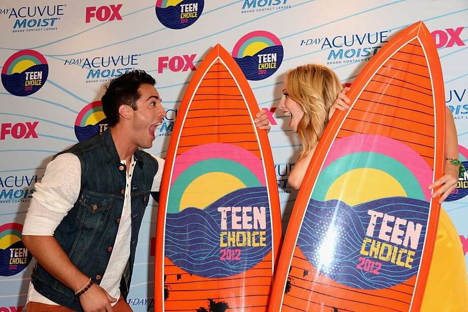 UNIVERSAL CITY, CA - JULY 22:  Actors Michael Trevino and Candice Accola, winners of Choice Fantasy/Sci-Fi Show award, pose in the press room during the 2012 Teen Choice Awards at Gibson Amphitheatre on July 22, 2012 in Universal City, California.  (Photo by Jason Merritt/Getty Images) Photo: Jason Merritt, Getty Images
