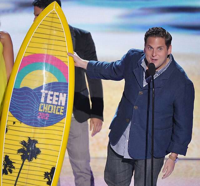 Jonah Hill accepts the award for choice comedy movie award onstage at the Teen Choice Awards on Sund