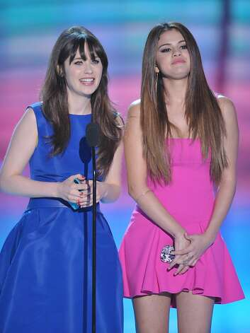 Zooey Deschanel, left, and Selena Gomez speak onstage at the Teen Choice Awards on Sunday, July 22, 2012, in Universal City, Calif. (Photo by John Shearer/Invision/AP) Photo: John Shearer, Associated Press