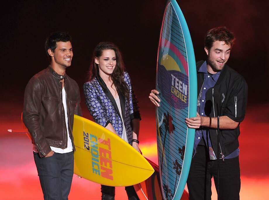 UNIVERSAL CITY, CA - JULY 22:  (L-R) Actors Taylor Lautner, Kristen Stewart, and Robert Pattinson accept the Ultimate Choice award onstage during the 2012 Teen Choice Awards at Gibson Amphitheatre on July 22, 2012 in Universal City, California.  (Photo by Kevin Winter/Getty Images) Photo: Kevin Winter, Getty Images