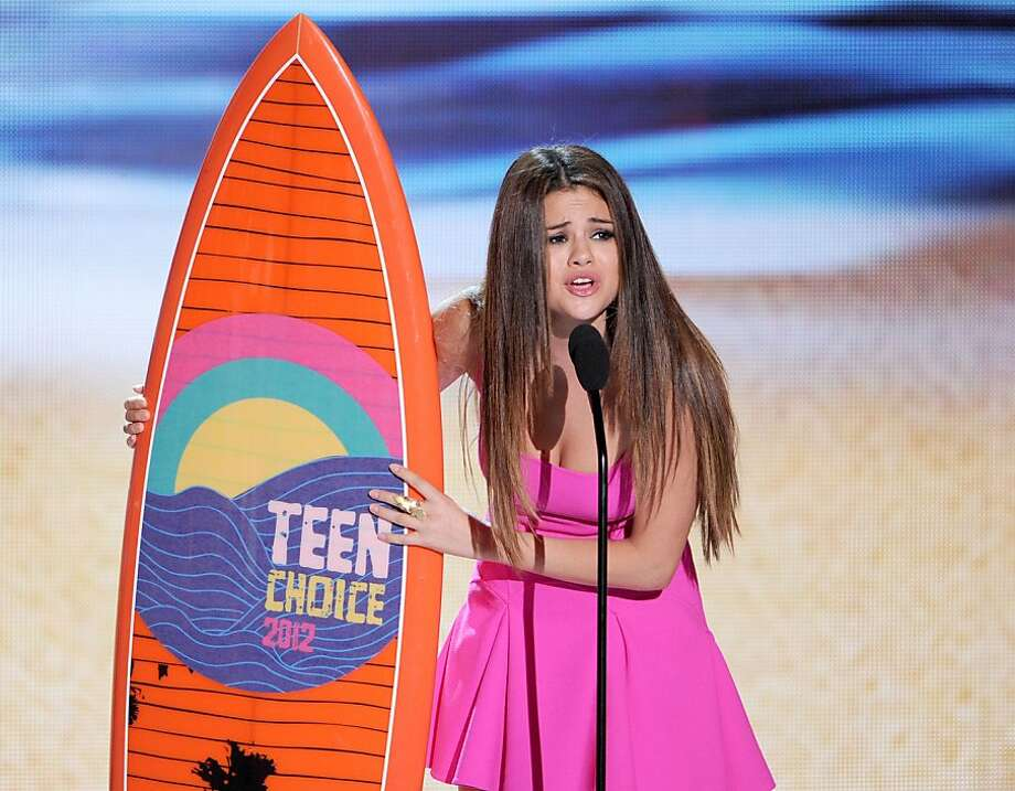 UNIVERSAL CITY, CA - JULY 22:  Singer Selena Gomez accepts the Choice Music Group award onstage during the 2012 Teen Choice Awards at Gibson Amphitheatre on July 22, 2012 in Universal City, California.  (Photo by Kevin Winter/Getty Images) Photo: Kevin Winter, Getty Images