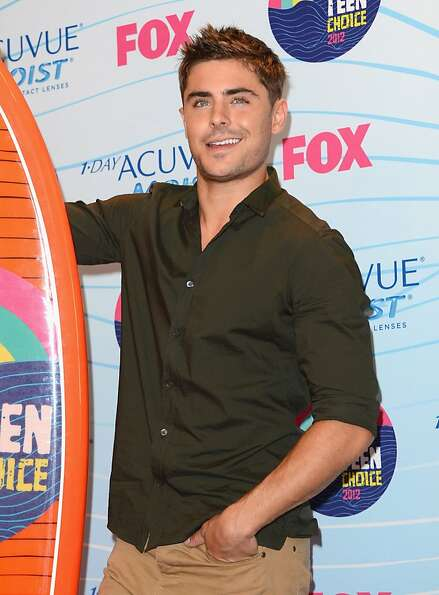 UNIVERSAL CITY, CA - JULY 22:  Actor Zac Efron poses with Choice Movie Actor award in the press room