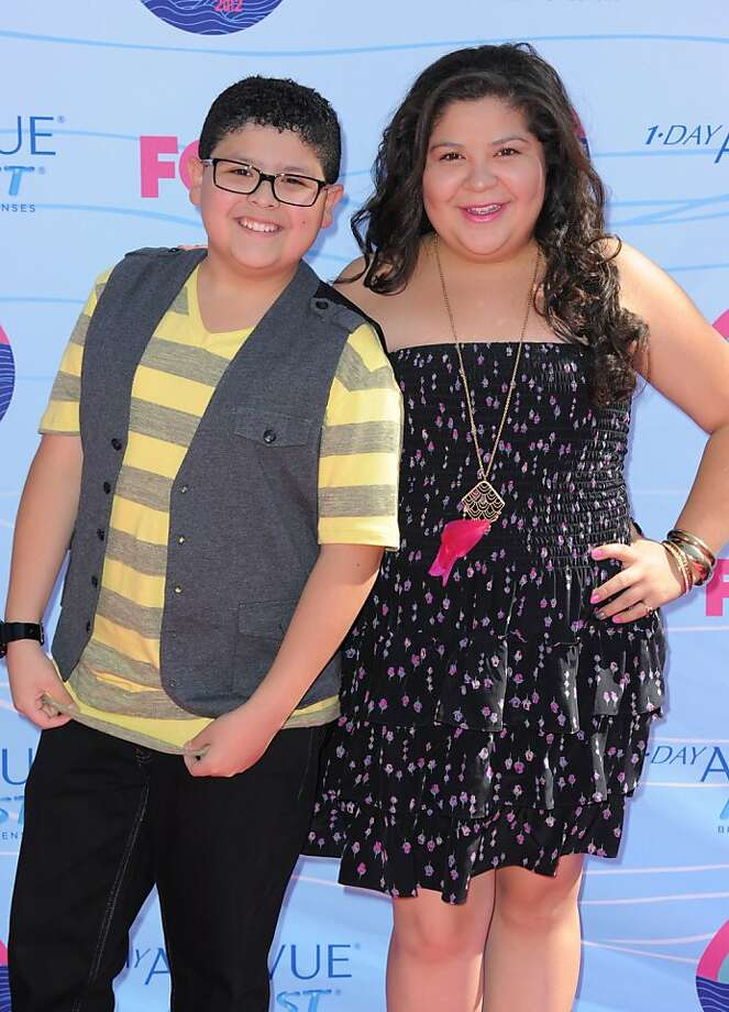 Rico Rodriguez, left, and Raini Rodriguez arrive at the Teen Choice Awards on Sunday, July 22, 2012, in Universal City, Calif. (Photo by Jordan Strauss/Invision/AP) Photo: Jordan Strauss, Associated Press