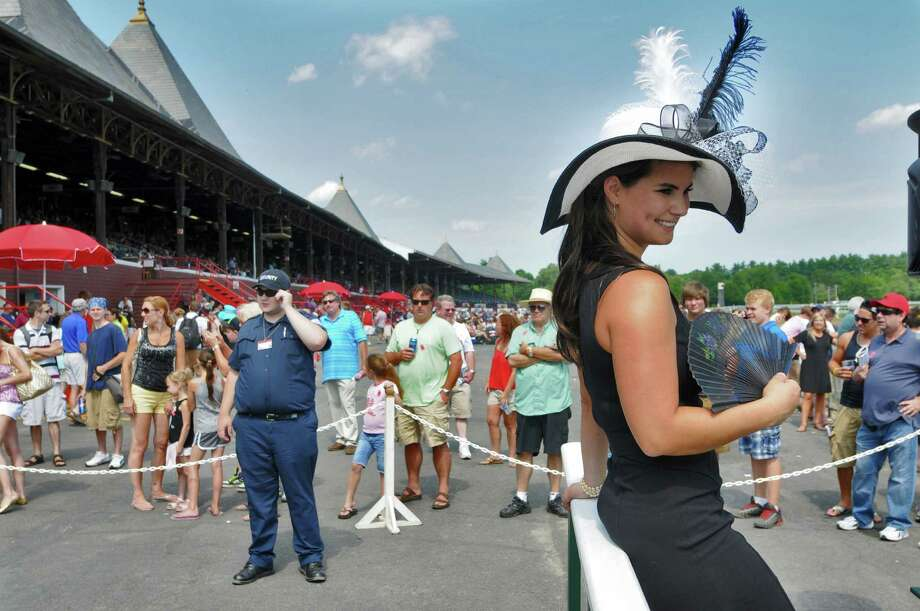 "Veronica Martin of Great Barrington, Mass. won the Fashionably Saratoga hat contest at the Saratoga Race Course on Sunday  July 22, 2012 in Saratoga Springs, NY.  She made the hat herself, and titled it ""Midnight Train to Georgia."" (Philip Kamrass / Times Union) Photo: Philip Kamrass / 00018525A"