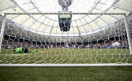 VANCOUVER, CANADA - JULY 22:  Barry Robson #14 of the Vancouver Whitecaps FC kicks the ball past Jon Busch #18 of the San Jose Earthquakes on a penalty kick during their MLS game July 22, 2012 at BC Place in Vancouver, British Columbia, Canada. The Whitecaps won 2-1. (Photo by Jeff Vinnick/Getty Images)