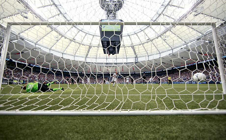 VANCOUVER, CANADA - JULY 22:  Barry Robson #14 of the Vancouver Whitecaps FC kicks the ball past Jon Busch #18 of the San Jose Earthquakes on a penalty kick during their MLS game July 22, 2012 at BC Place in Vancouver, British Columbia, Canada. The Whitecaps won 2-1. (Photo by Jeff Vinnick/Getty Images) Photo: Jeff Vinnick, Getty Images