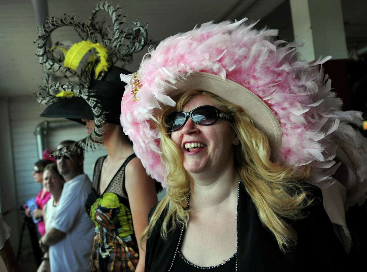 Arianna Huckins of Schenectady wears a feather hat in honor of two breast cancer survivors she knows, as she and Casey Coyle of Saratoga Springs, left, wait for the start of judging in the Fashionably Saratoga hat contest at the Saratoga Race Course on Sunday July 22, 2012 in Saratoga Springs, NY. Coyle placed third. (Philip Kamrass / Times Union)