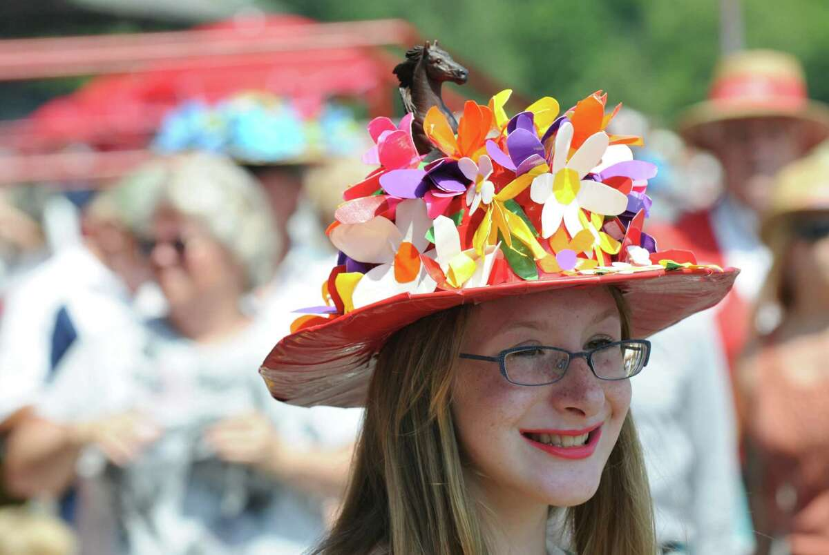 Mikayla Schaefer of Schenectady, 12, placed third with her winner's circle themed hat, made partially with duct tape, in the Kreative Kids hat contest, at the Saratoga Race Course on Sunday July 22, 2012 in Saratoga Springs, NY. (Philip Kamrass / Times Union)