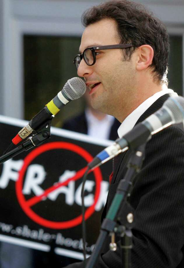 FILE - In this file photo from Nov. 3, 2010, documentary filmmaker Josh Fox speaks at a rally of protestors against Marcellus Shale drilling and hydraulic fracturing in Pittsburgh. Researchers say the claim that fracking has been linked to increased cancer rates in Texas is simply wrong. Fox, an Oscar-nominated filmmaker who uses the claim in a new film, declined to acknowledge the error when told of researchers who say he's doing a disservice to people with cancer by misrepresenting health data. (AP Photo/Keith Srakocic, File) Photo: Keith Srakocic