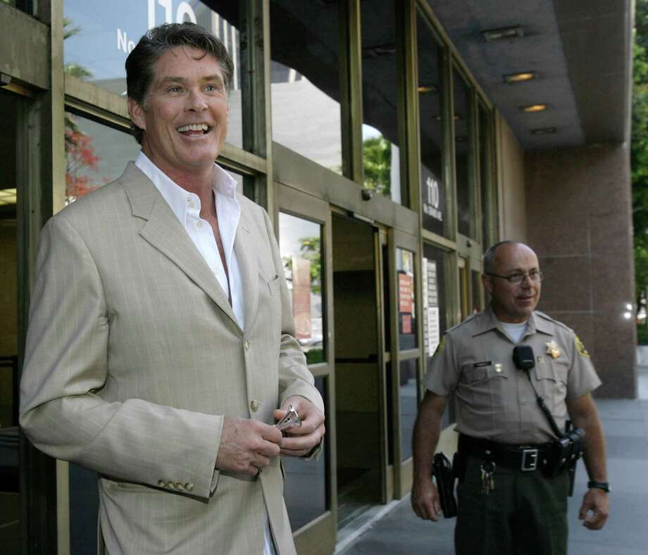 Actor David Hasselhoff smiles as he leaves court after a child custody hearing Friday, June 15,  2007,  in Los Angeles. Hasselhoff and his ex-wife, Pamela Bach, are battling over custody of their two daughters. (AP Photo/Nick Ut) Photo: Nick Ut / AP