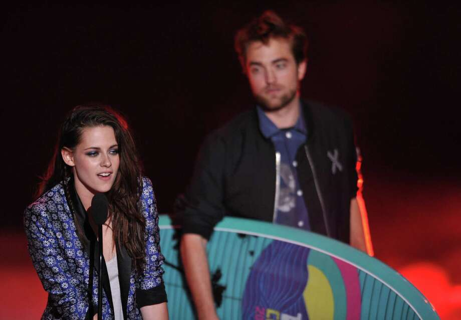 Kristen Stewart, left, and Robert Pattinson accept the award for Ultimate Choice at the Teen Choice Awards on Sunday, July 22, 2012, in Universal City, Calif. (Photo by John Shearer/Invision/AP) Photo: John Shearer / Invision